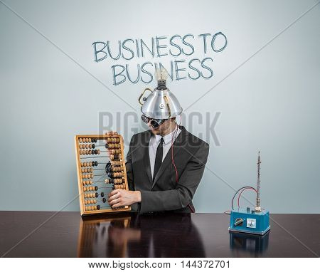 Business to business concept with businessman and abacus