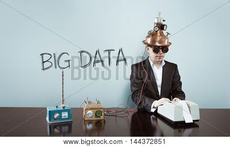 Big data concept with vintage businessman and calculator at office