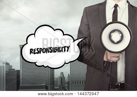 Responsibility text on speech bubble with businessman holding megaphone