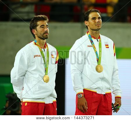 RIO DE JANEIRO, BRAZIL - AUGUST 12, 2016: Olympic champions Mark Lopez (L) and Rafael Nadal of Spain during medal ceremony after  victory at men's doubles final of the Rio 2016 Olympic Games