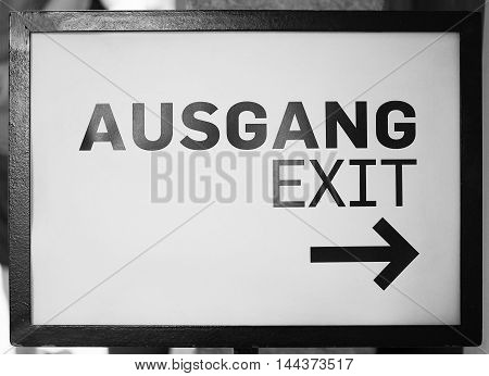 Ausgang sign meaning exit in German language in black and white