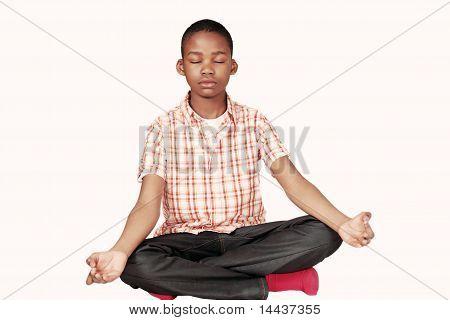 Ethnic boy yoga meditation