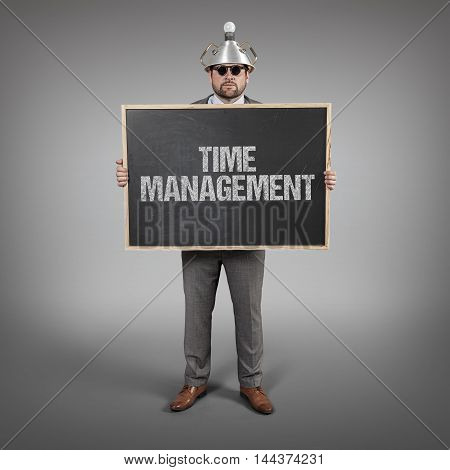 Time management text on blackboard with science businessman holding blackboard sign