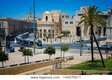 JERUSALEM, ISRAEL - JUNE 2, 2015: Modern tram near the Old City of Jerusalem. June 2, 2015. Jerusalem, Israel.