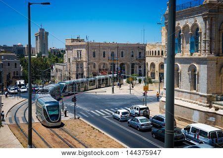 JERUSALEM, ISRAEL - JUNE 2, 2015: Modern tram near the Old City of Jerusalem. June 2, 2015. Jerusalem, Israel.