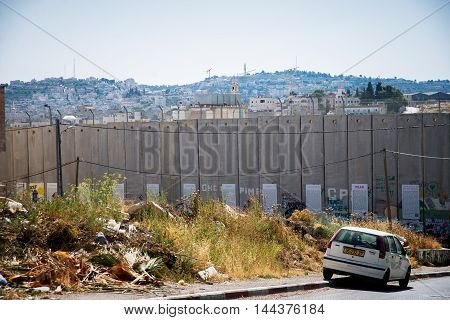 BETHLEHEM, PALESTINE - JUNE 2, 2015: The Israeli West Bank barrier  is a separation barrier. Upon completion, its total length will be about 700 kilometres. June 2, 2015. Bethlehem, Palestine.