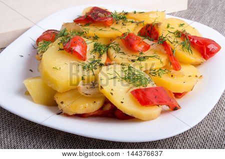 Slices Of Stewed Potatoes And Peppers On Sackcloth