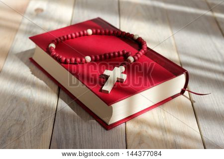 the rosary on the red book .