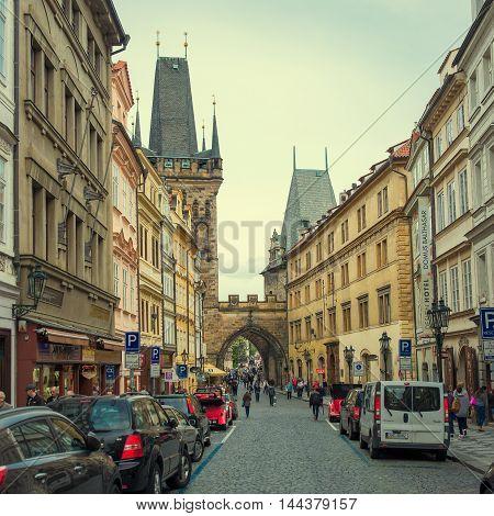 PRAGUE, CZECH REPUBLIC - MAY 6, 2015: The popular tourist itinerary Prague to Charles Bridge