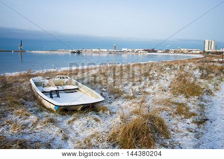 catamaran on the shore in the winter