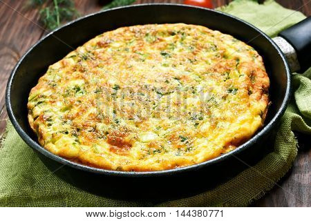 Omelet in frying pan close up view shallow depth of field