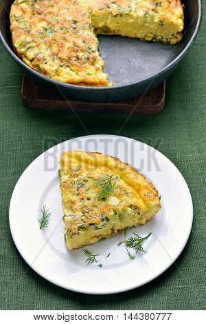 Piece of omelette with herbs cheese and zucchini