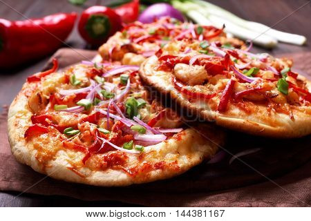 Meat naan pizza with chicken and vegetables