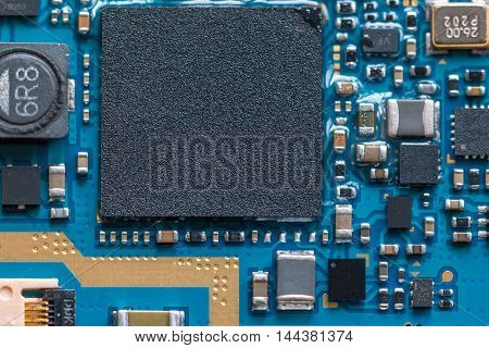 Electronic circuit chip on pcb board. Close up shot.