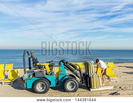 The Hague the Netherlands - August 25 2016: beach worker with folding chairs on the beach