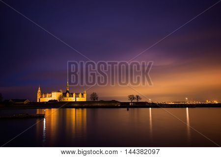 Castle on the beach at night in Helsingor