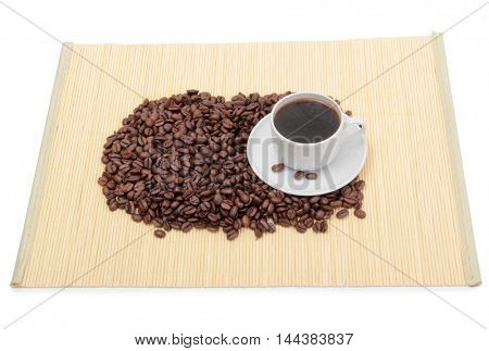 Coffee beans and a white cup on table