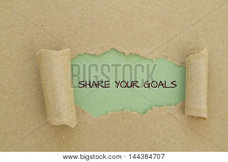 Share your goals message written under torn paper.