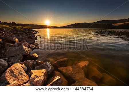 Sunset on the water reservoir Kretinka. Moravian landscape.