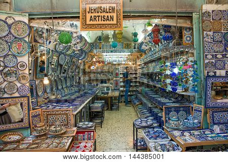 JERUSALEM, ISRAEL - JUNE 1, 2015: Bazaar in Old City offers middle east traditional products and souvenirs