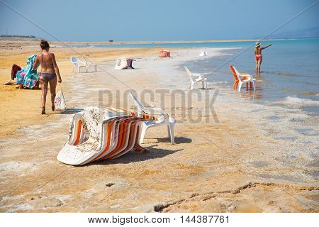 JERUSALEM, DEAD SEA - JUNE 3, 2015: Tourists relax on the beach of the Dead Sea