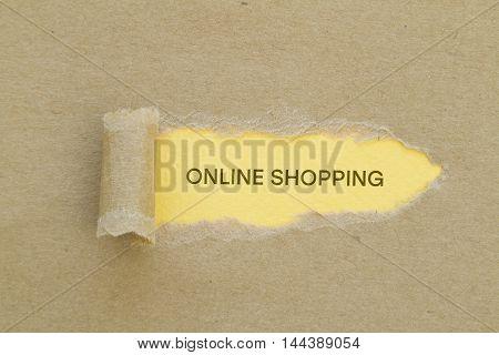 Online shopping written under torn paper .