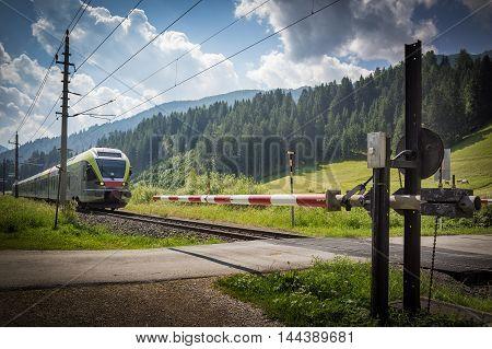 A train reaches a rail crossing in Lienz Austria
