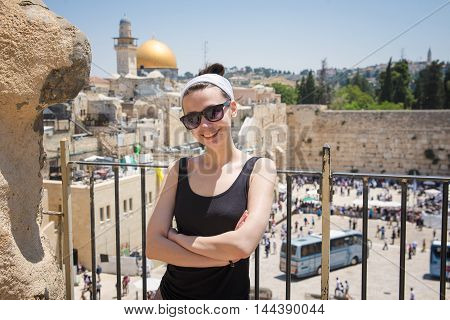 Girl on a viewing platform in front of the Wailing Wall