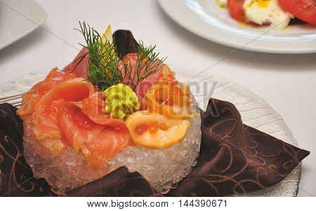 a dish of salmon on the table in a plate