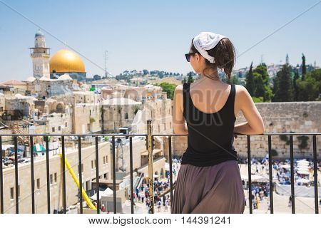 Girl looks at the Wailing Wall in Jerusalem