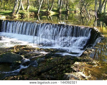 Beautiful waterfall in the riverside (Oleiros - Portugal)