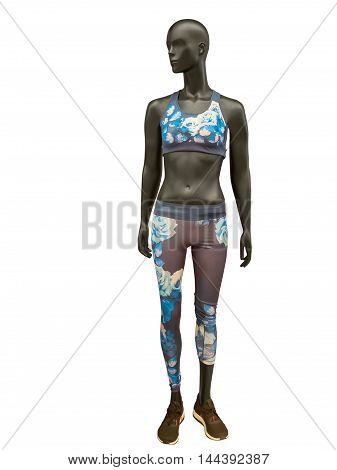 Female mannequin dressed in colorful sport athletics clothes isolated on a white background. No brand names or copyright objects.