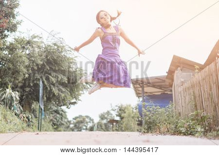 Happy Young Woman Jumping Beauty Girl Having Fun Outdoor. Freedom Concept