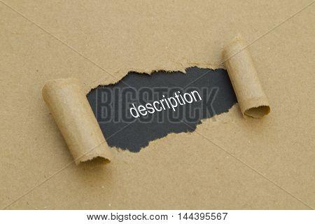 Description word written under torn paper .