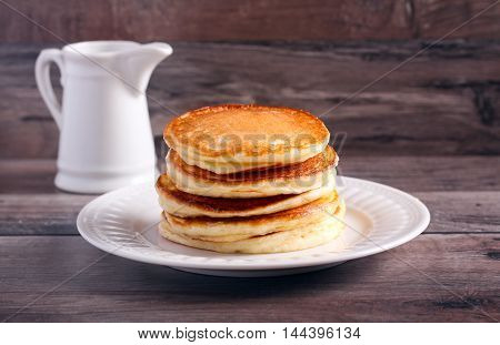 Stack of classic pancakes on plate selective focus