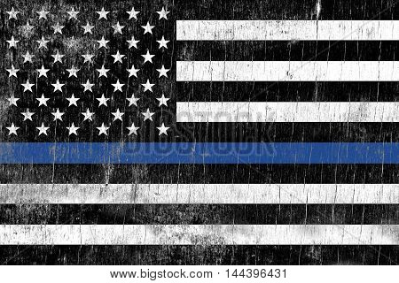 A law enforcement police support flag painted over a cracking wooden texture.