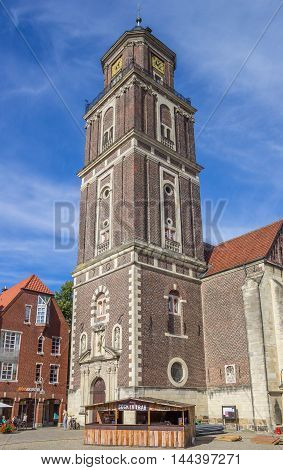 COESFELD, GERMANY - AUGUST 17, 2016: Coctailbar and church tower on the square in Coesfeld, Germany