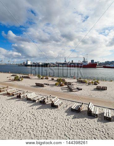 beach at Aarhus in Denmark, harbor in the background