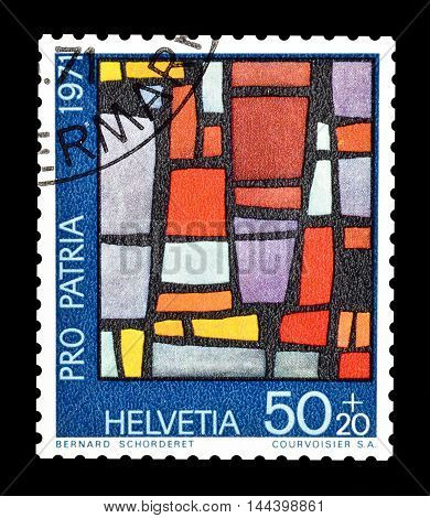 SWITZERLAND - CIRCA 1971 : Cancelled postage stamp printed by Switzerland, that shows church window.
