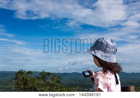Side View Of Asian Girl Relaxing Outdoors In The Daytime, Travel On Vacation.