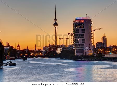 Sunset at the river Spree in Berlin with the famous Television Tower