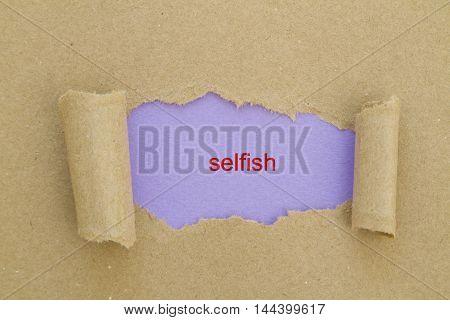 Selfish word written under torn paper .