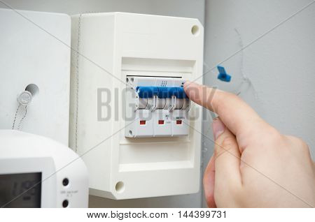 Man Switches Automatic Fuse. Electric Equipment Close Up
