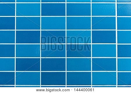 A blue tiled background with relatively small tiles