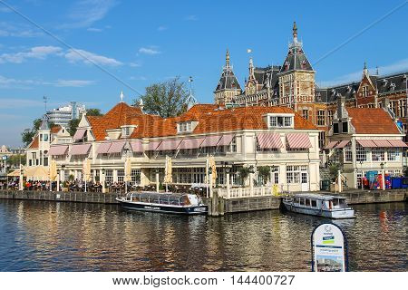 Amsterdam the Netherlands -October 03 2015: Tourist boats on the canal of Amsterdam in historic city centre
