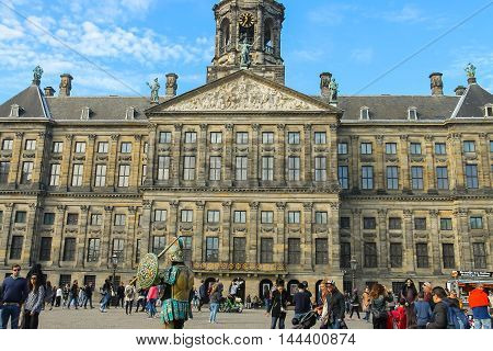 Amsterdam the Netherlands -October 03 2015: Tourists walking next to the Royal Palace on Dam Square