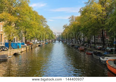 Amsterdam the Netherlands -October 03 2015: Small boats on the canal in historic city centre