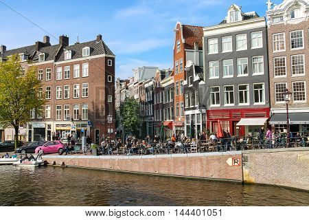 Amsterdam the Netherlands -October 03 2015: Tourists walking in historic city centre
