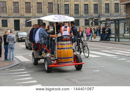 Amsterdam the Netherlands -October 03 2015: People riding beer bicycle in historical city centre