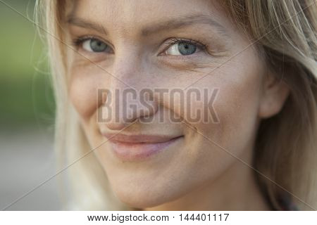 face of a woman with natural skin closeup
